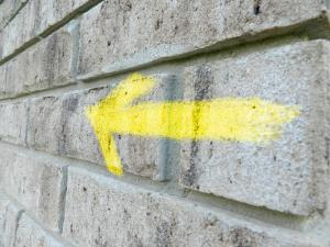 Arrow on Brick Wall